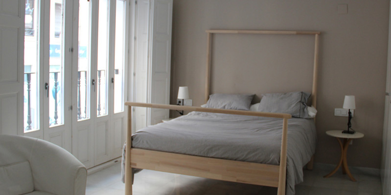 Camera da letto in un appartamento studio